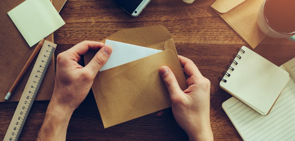 Hands opening a letter